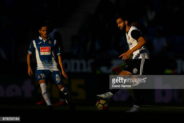 Martin Montoya of Valencia CF competes for the ball with Pablo Piatti of RCD Espanyol during the La Liga match between Espanyol and Valencia at...