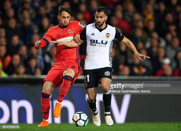 Martin Montoya of Valencia competes for the ball with Adnan Januzaj of Real Sociedad during the La Liga match between Valencia CF and Real Sociedad...