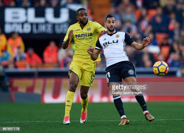Martin Montoya of Valencia competes for the ball with Cedric Bakambu of Villarreal during the La Liga match between Valencia and Villarreal at...
