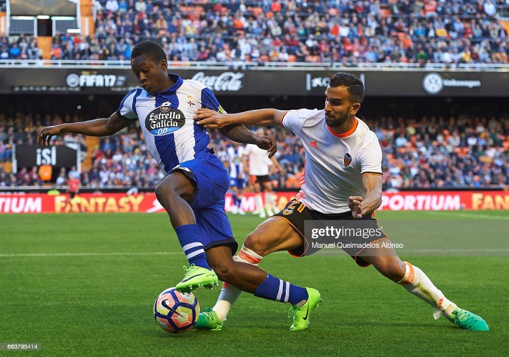Martin Montoya (R) of Valencia competes for the ball with Marlos Moreno of Deportivo de La Coruna during the La Liga match between Valencia CF and Deportivo de La Coruna at Mestalla Stadium on April 2, 2017 in Valencia, Spain.