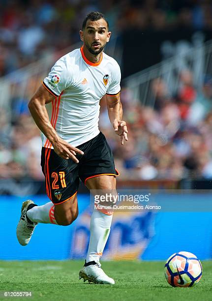 Martin Montoya of Valencia runs with the ball during the La Liga match between Valencia CF and Atletico de Madrid at Mestalla Stadium on October 02...