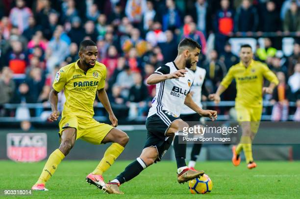Martin Montoya Torralbo of Valencia CF fights for the ball with Cedric Bakambu of Villarreal CF during the La Liga 201718 match between Valencia CF...
