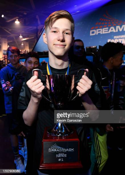 Martin MrSavage Foss Andersen a player for 100 Thieves holds the championship trophy after winning DreamHack Anaheim featuring Fortnite during...