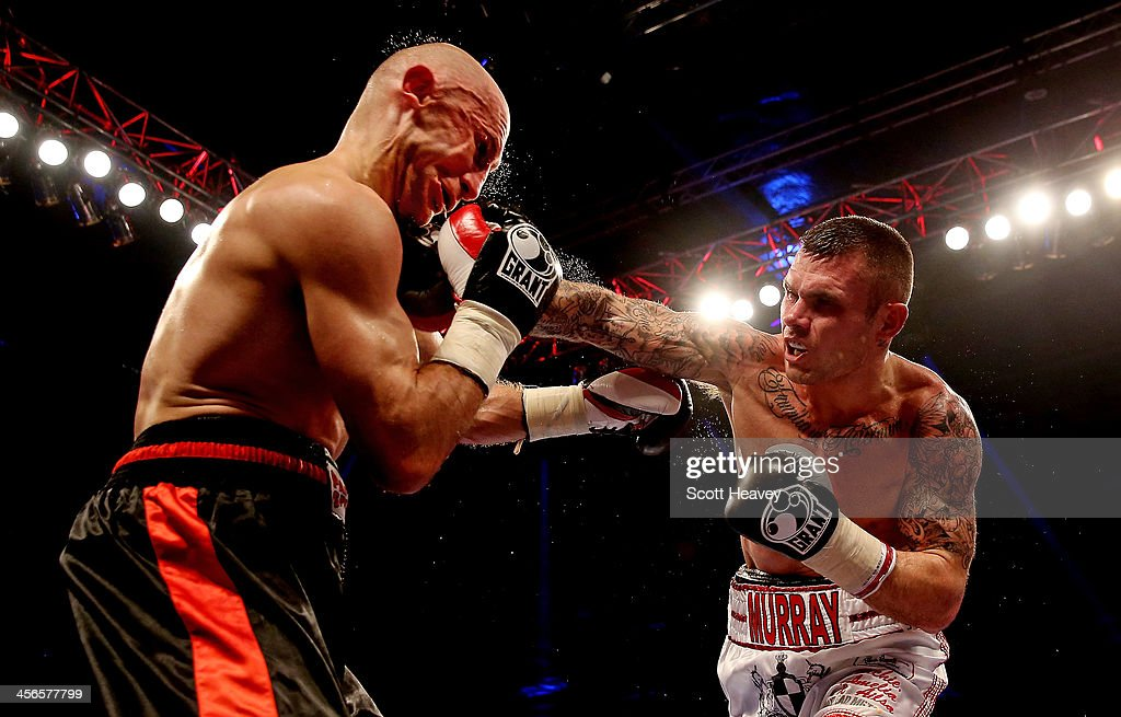 Martin Murray (R) lands a right jab on the chin of Sergey Khomitsky during their Middleweight bout at ExCel on December 14, 2013 in London, England.