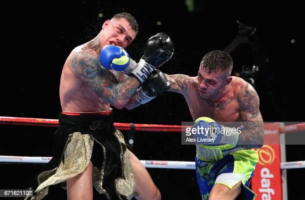 Martin Murray lands a right shot on Gabriel Rosado during the WBA InterContinental Middleweight title fight between Martin Murray and Gabriel Rosado...