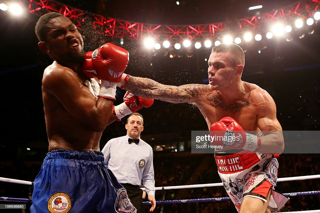 Martin Murray of Great Britain (R) lands the knockout blow during his WBA Interim Middleweight Title against Jorge Navarro of Venezuela at the MEN Arena on November 24, 2012 in Manchester, England.