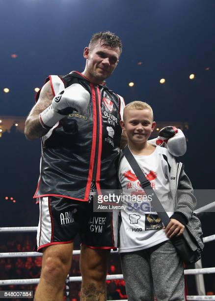 Martin Murray poses wihis son as he celebrates victory over Arman Torosyan after the WBSS Super Middleweight Substitute fight at Echo Arena on...
