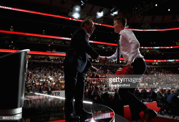 Martin Necas 12th overall pick of the Carolina Hurricanes shakes the hand of NHL Commissioner Gary Bettman onstage during Round One of the 2017 NHL...