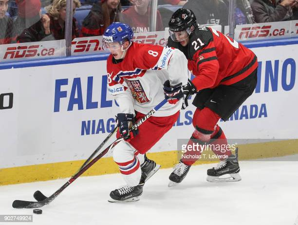 Martin Necas of Czech Republic skates the puck past Brett Howden of Canada during the first period of play in the IIHF World Junior Championships...