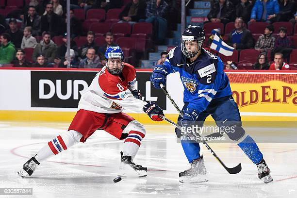Martin Necas of Team Czech Republic and Miro Heiskanen of Team Finland skate after the puck during the IIHF World Junior Championship preliminary...