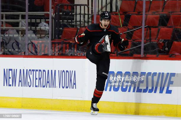 Martin Necas of the Carolina Hurricanes celebrates after scoring the game-winning goal in overtime of their game against the Tampa Bay Lightning at...