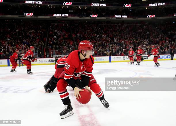Martin Necas of the Carolina Hurricanes participates in a dodge ball Storm Surge after defeating the Winnipeg Jets during an NHL game on January 21...