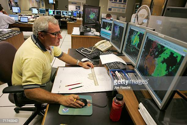 Martin Nelson the lead forcaster tracks Tropical Storm Ernesto at the National Hurricane Center August 29 2006 in Miami Florida The National...