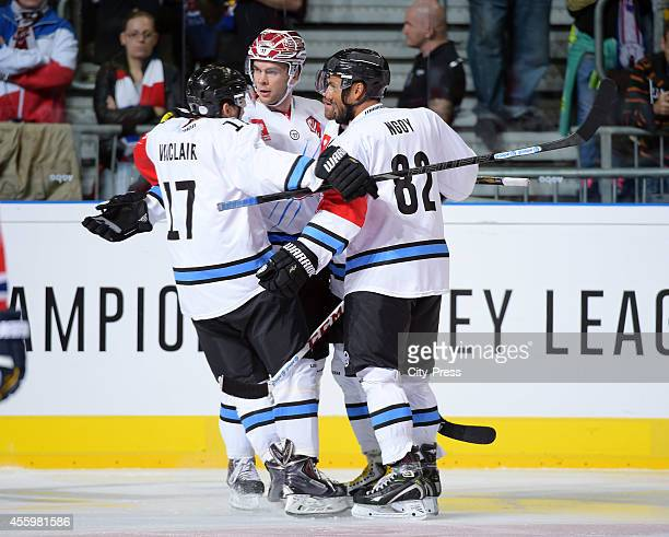 Martin Ness MarcAntoine Pouliot and Michael Ngoy of HC FribourgGotteron celebrate after scoring the 20 during the Champions Hockey League group stage...