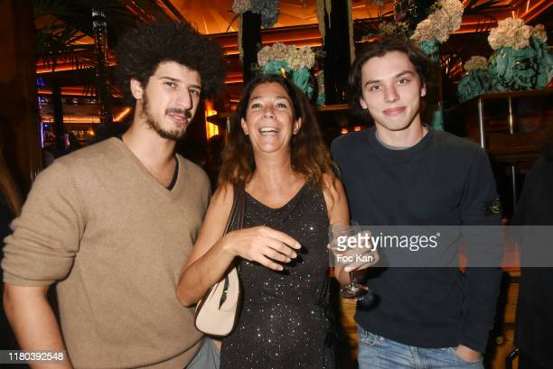 Martin Nigard Sandrine Taddei and nephew Diego Taddei attend the Prix Double Dôme 2019 music/litterature and Art Award at Brasserie Le Dôme on...