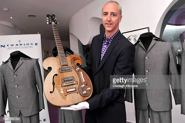 Martin Nolan Executive Director of Julien's Auctions displays a rare Vox guitar played by George Harrison and John Lennon which is exhibited at the...