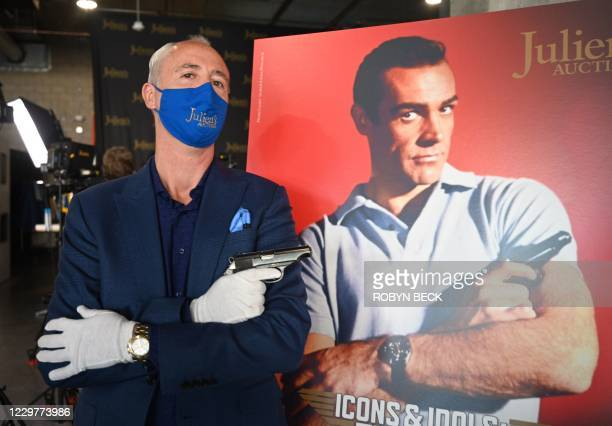 Martin Nolan, executive director of Julien's Auctions, displays the Walther PP handgun used by Sean Connery as James Bond in the first James Bond...