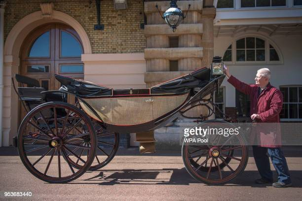 Martin Oates Senior Carriage Restorer polishes the Ascot Landau which will be used in the case of dry weather at the wedding of Prince Harry and...