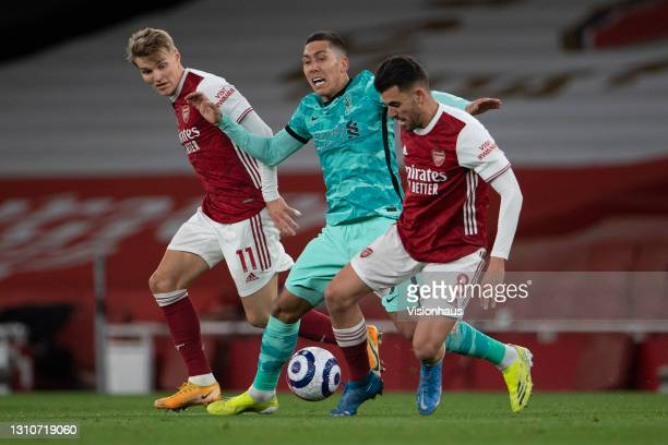 Martin Odegaard and Dani Ceballos of Arsenal and Roberto Flamino of Liverpool during the Premier League match between Arsenal and Liverpool at...