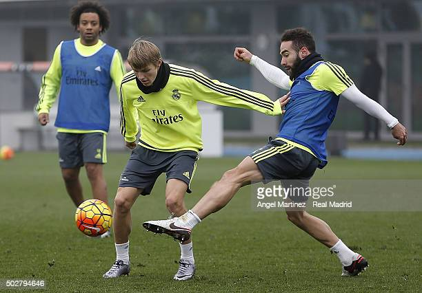 Martin Odegaard and Daniel Carvajal of Real Madrid in action during a training session at Valdebebas training ground on December 29 2015 in Madrid...