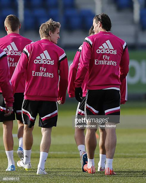 Martin Odegaard and Gareth Bale of Real Madrid chat during a training session at Valdebebas training ground on January 29 2015 in Madrid Spain