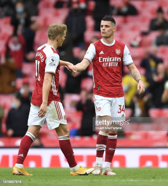 Martin Odegaard and Granit Xhaka of Arsenal during the Premier League match between Arsenal and Brighton & Hove Albion at Emirates Stadium on May 23,...
