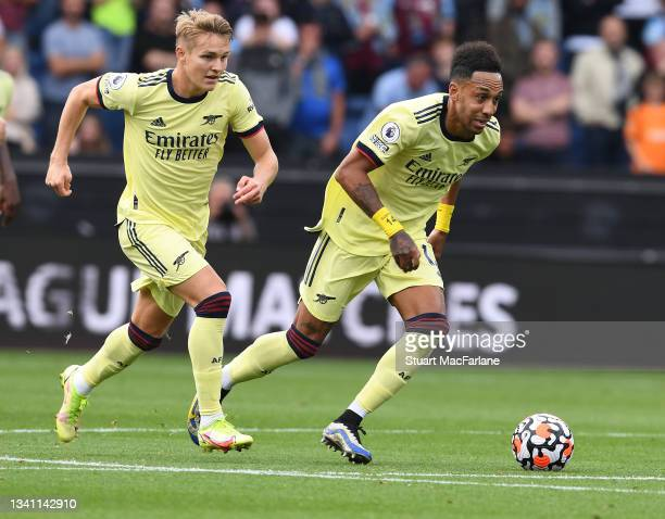 Martin Odegaard and Pierre-Emerick Aubameyang of Arsenal during the Premier League match between Burnley and Arsenal at Turf Moor on September 18,...