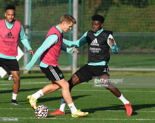Martin Odegaard and Thomas Partey of Arsenal during the Arsenal 1st team training session at London Colney on October 21, 2021 in St Albans, England.