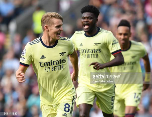 Martin Odegaard celebrates scoring the Arsenal goal during the Premier League match between Burnley and Arsenal at Turf Moor on September 18, 2021 in...