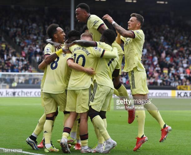 Martin Odegaard celebrates scoring the Arsenal goal with Pierre-Emerick Aubameyang, Emile Smith Rowe, Gabriel Ben White and Bukayo Saka during the...