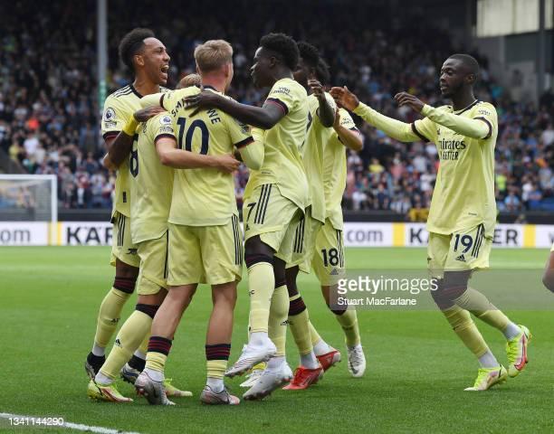 Martin Odegaard celebrates scoring the Arsenal goal with Pierre-Emerick Aubameyang, Emile Smith Rowe, Gabriel Ben White and Nicolas Pepe during the...