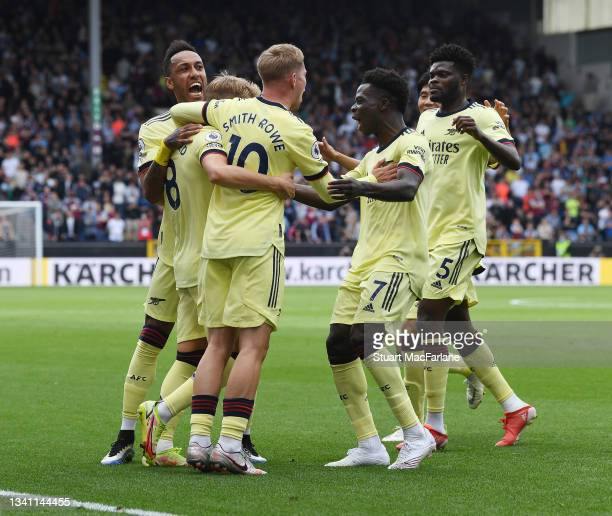 Martin Odegaard celebrates scoring the Arsenal goal with Pierre-Emerick Aubameyang, Emile Smith Rowe, Bukayo Saka and Thomas Partey during the...