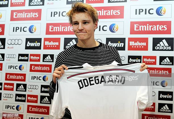 Martin Odegaard from Norway holds his new Real Madrid shirt during a press conference at Real Madrid's Valdebebas training grounds after he signed...