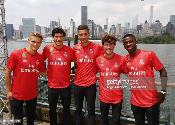 Martin Odegaard Jesus Vallejo Javi Sanchez Alvaro Odriozola and Vinicius Jr of Real Madrid pose during the new third kit launch on August 6 2018 in...