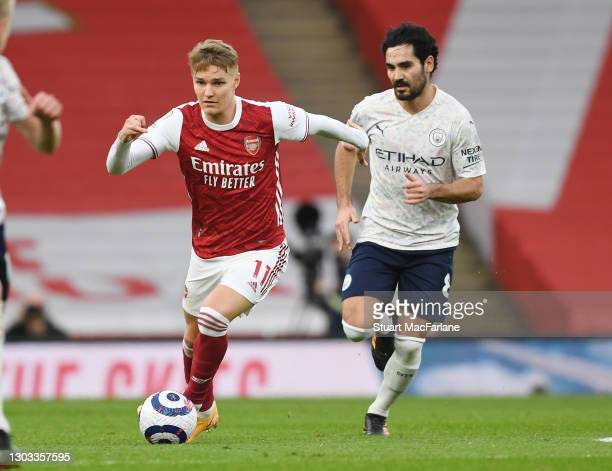 Martin Odegaard of Arsenal breaks past Ilkay Gündoğan of Man City during the Premier League match between Arsenal and Manchester City at Emirates...