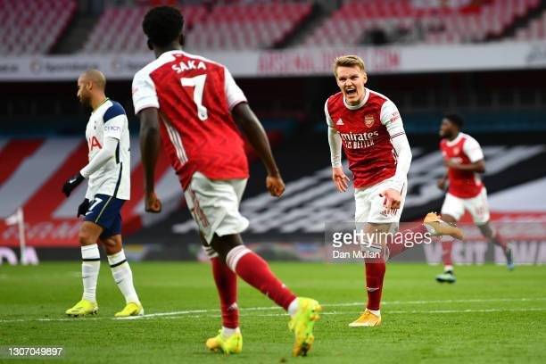Martin Odegaard of Arsenal celebrates after scoring their side's first goal during the Premier League match between Arsenal and Tottenham Hotspur at...