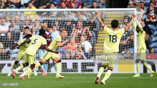 Martin Odegaard of Arsenal celebrates after scoring their side's first goal during the Premier League match between Burnley and Arsenal at Turf Moor...