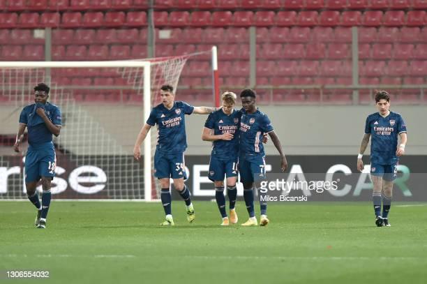 Martin Odegaard of Arsenal celebrates with team mates Granit Xhaka and Bukayo Saka after scoring their side's first goal during the UEFA Europa...