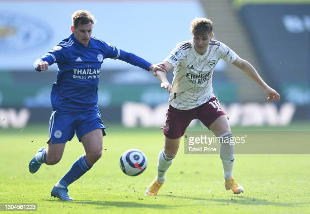 Martin Odegaard of Arsenal challenges Marc Albrighton of Leicester during the Premier League match between Leicester City and Arsenal at The King...