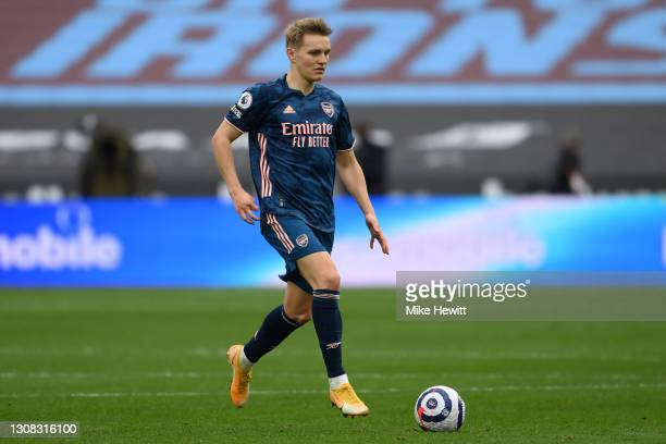 Martin Odegaard of Arsenal in action during the Premier League match between West Ham United and Arsenal at London Stadium on March 21, 2021 in...