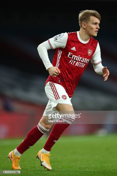 Martin Odegaard of Arsenal runs on during the Premier League match between Arsenal and Manchester City at Emirates Stadium on February 21, 2021 in...