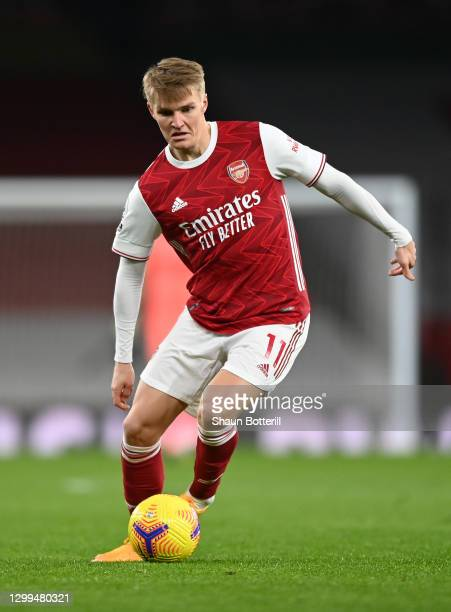 Martin Odegaard of Arsenal runs with the ball during the Premier League match between Arsenal and Manchester United at Emirates Stadium on January...