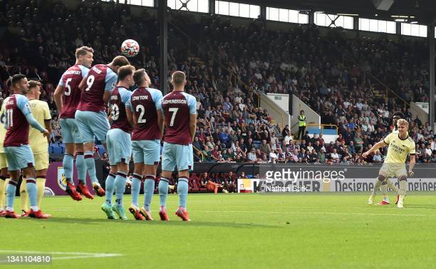 Martin Odegaard of Arsenal scores their side's first goal during the Premier League match between Burnley and Arsenal at Turf Moor on September 18,...