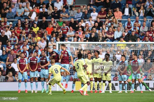 Martin Odegaard of Arsenal scores their team's first goal during the Premier League match between Burnley and Arsenal at Turf Moor on September 18,...