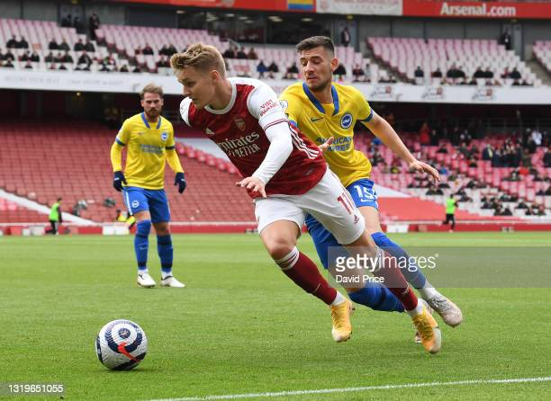 Martin Odegaard of Arsenal takes on Jakub Moder of Brighton during the Premier League match between Arsenal and Brighton & Hove Albion at Emirates...