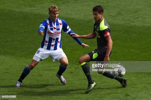 Martin Odegaard of Heerenveen battles for the ball with Marco van Ginkel of PSV during the Dutch Eredivisie match between SC Heerenveen and PSV...