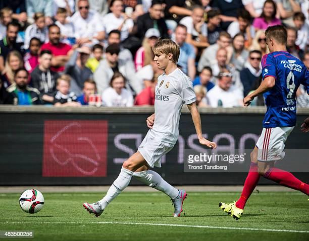Martin Odegaard of Real Madrid and Rasmus Lindkvist and Vaalerenga during Preseason Friendly match between Vaalerenga and Real Madrid at Ullevaal...