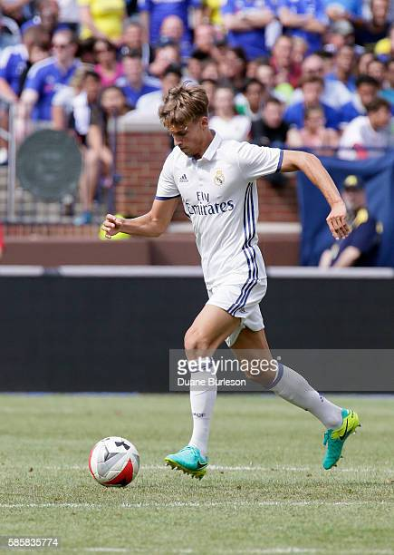 Martin Odegaard of Real Madrid brings the ball up field against Chelsea at Michigan Stadium on July 30 2016 in Ann Arbor Michigan