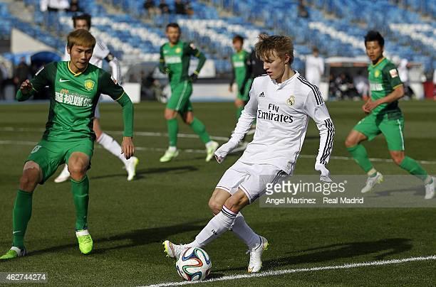 Martin Odegaard of Real Madrid Castilla in action during a friendly match between Real Madrid Castilla and Beijing Guoan at Estadio Alfredo Di...