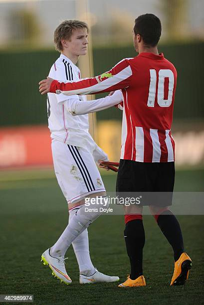 Martin Odegaard of Real Madrid Castilla shakes hands Martin Bengoa of Athletic Club B at the end of the Segunda Division B match between Real Madrid...
